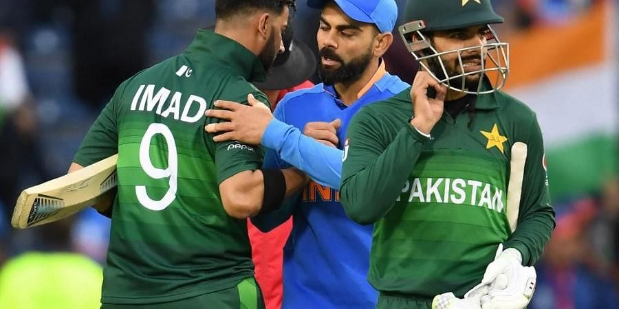 India's captain Virat Kohli (C) embraces Pakistan's Imad Wasim (L). (Photo   AFP)