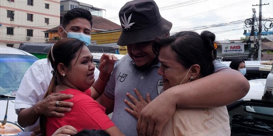 A man is embraced by two women outside Insein prison in Yangon
