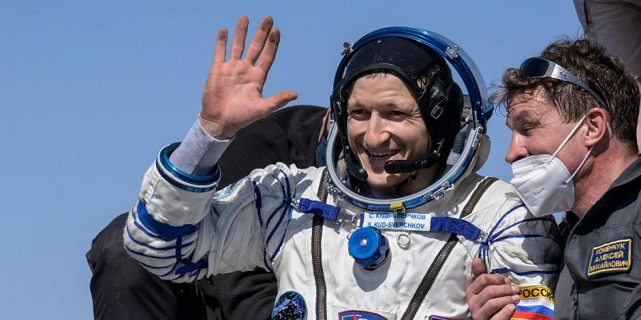 Roscosmos cosmonaut Sergey Kud-Sverchkov is helped out of the Soyuz MS-17 spacecraft