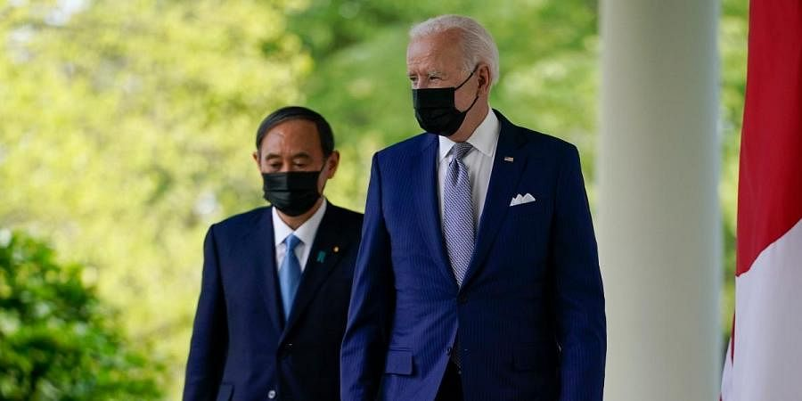 US President Joe Biden (R) with Japan PM Yoshihide Suga walks from the Oval Office to speak at a news conference