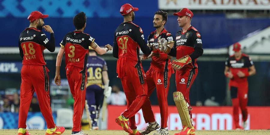RCB players celebrate the dismissal of KKR skipper Eoin Morgan in an IPL 2021 match in Chennai