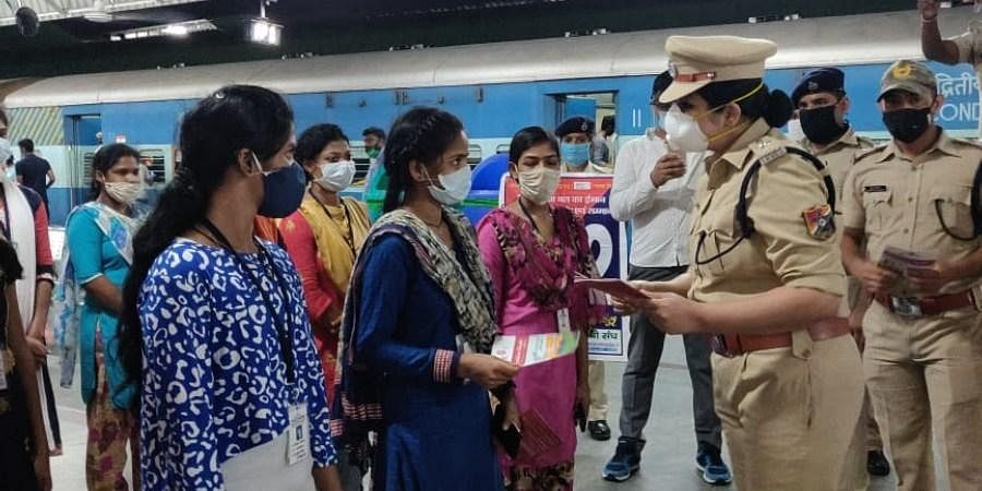 RPF cops counselling women passengers on safety measures and getting their feedback on improvements needed at KSR railway station in Bengaluru