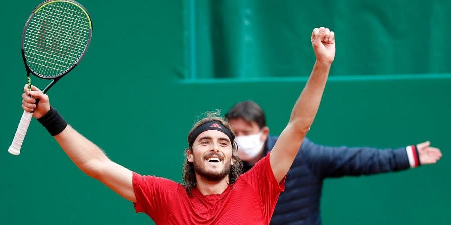 Stefanos Tsitsipas of Greece celebrates after defeating Andrey Rublev of Russia during the Monte Carlo Tennis Masters tournament finals in Monaco
