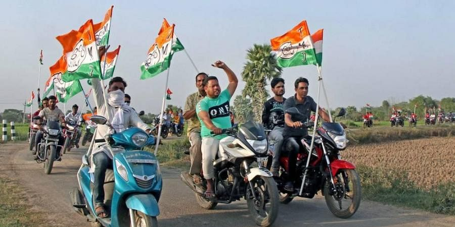 Trinamool Congress supporters take out a motorcycle rally during a campaign for the West Bengal Assembly polls, at Gargaria in Birbhum district.