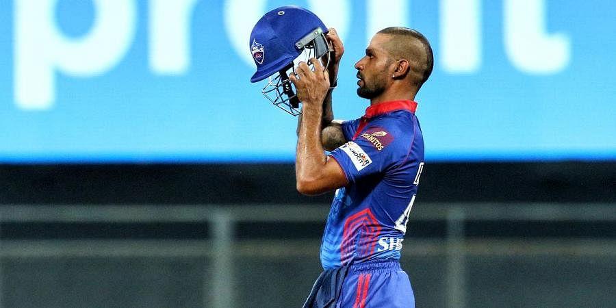 Delhi Capitals batsman Shikhar Dhwan fixes his helmet during an IPL 2021 match against Punjab Kings
