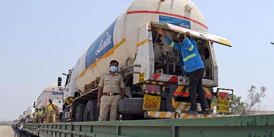 Empty tankers are loaded on a goods train at Kalamboli to bring liquid oxygen from other states in Mumbai