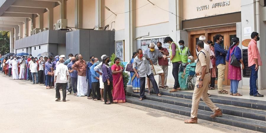Peoplestanding in queue at the Covid 19 vaccination centre in Thiruvananthapuram. (Photo | BP Deepu, EPS)