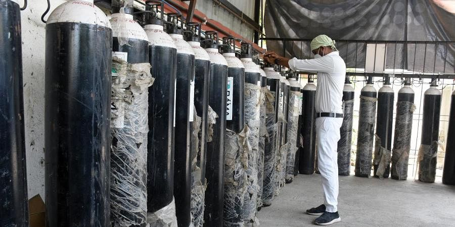 A medical hospital staff checks the oxygen cylinders, amid a surge in COVID-19 cases, in Surat