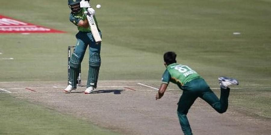 South Africa's Aiden Markram (L) plays a shot from a ball delivered by Pakistan's Mohammad Hasnain (R) during the first ODI