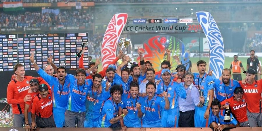 Indian cricketers pose with the trophy as they celebrate after beating Sri Lanka in the ICC Cricket World Cup 2011 final match at The Wankhede Stadium in Mumbai. (Photo | AFP)
