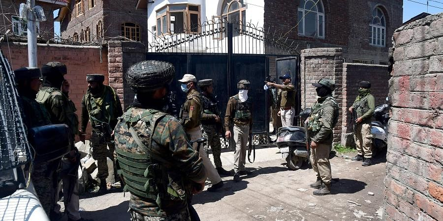 Police personnel at BJP leader Anwar Khan's residence who was attacked by terrorists at Nowgam, in Srinagar on Thursday