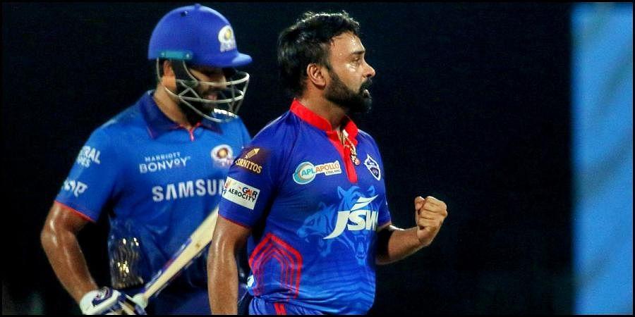 Delhi Capitals' Amit Mishra celebrates the wicket of Mumbai Indians skipper Rohit Sharma during an IPL 2021 match in Chennai