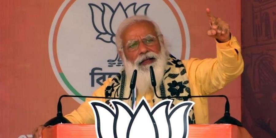 PM Narendra Modi at a poll campaign in Asansol