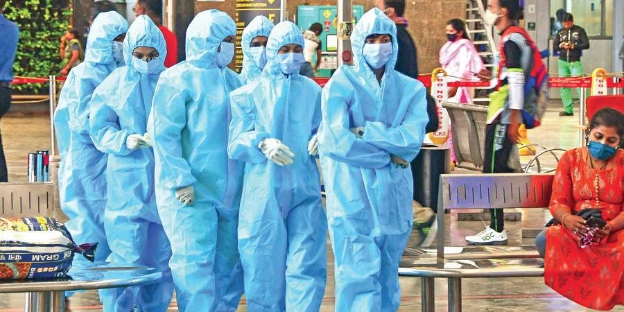 Healthcare workers arrive at CSMT railway station to screen passengers following the surge in Covid-19 cases in Mumbai. (Photo | PTI)