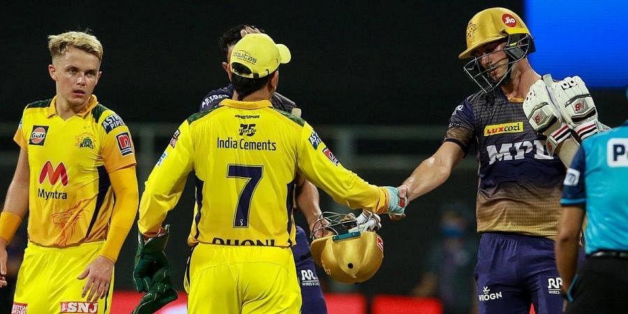 Kolkata Knight Riders' Pat Cummins congratulates Chennai Super Kings players after the latters' win in an IPL 2021 match in Mumbai
