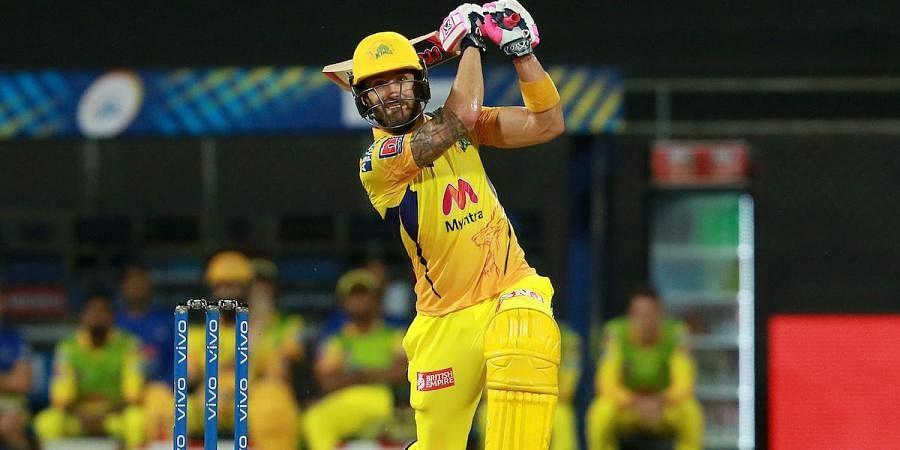Chennai Super Kings' Faf duPlessis scores a boundary during an IPL 2021 match against Kolkata Knight Rider