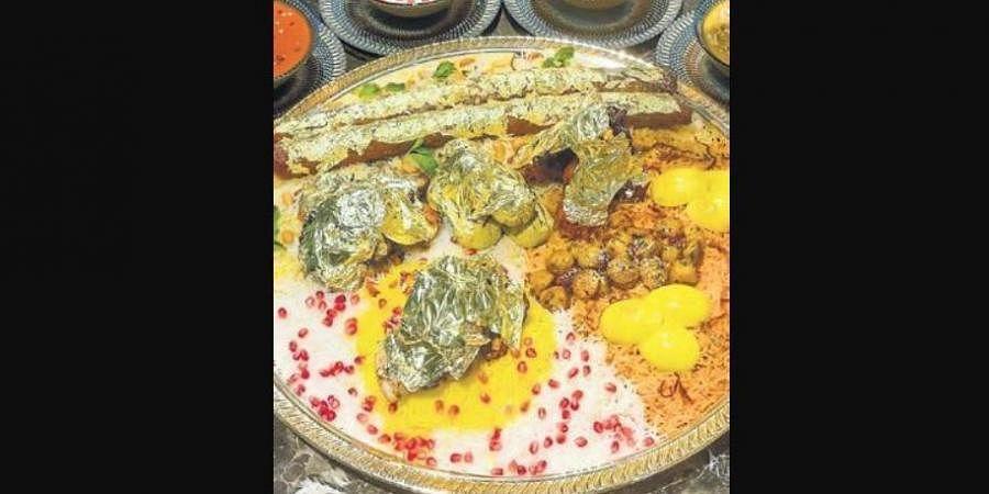 The platter includes Gold Leaf kababs Kashmiri lamb seekh kababs, old Delhi lamb chops, Rajput chicken kababs, Mughlai koftas and malai chicken roast served on a bed of saffron-infused biryani.