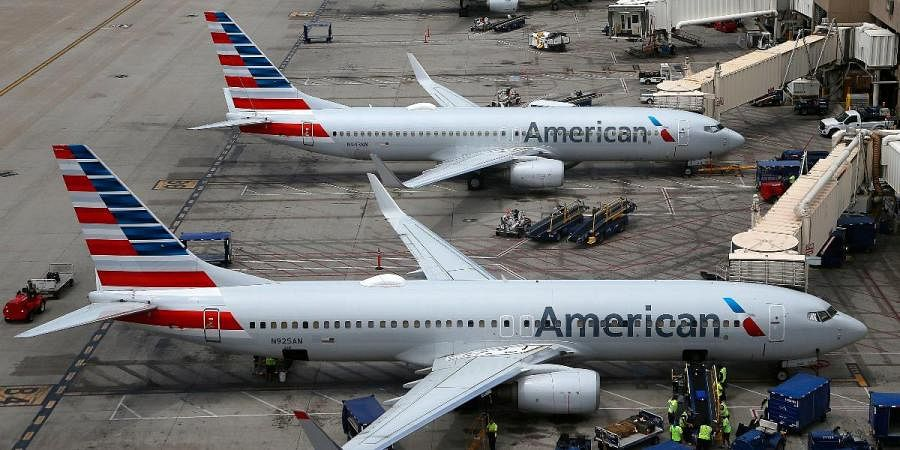 American Airlines planes are parked on the tarmac at Phoenix Sky Harbor International Airport in Phoenix