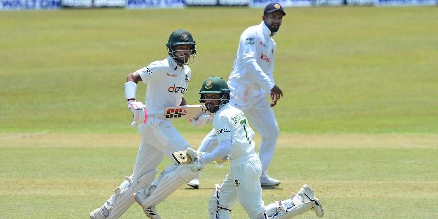Bangladesh's Mominul Haque (R) and Najmul Hossain run between wickets during the 2nd day of the First test against Sri Lanka in Pallekele