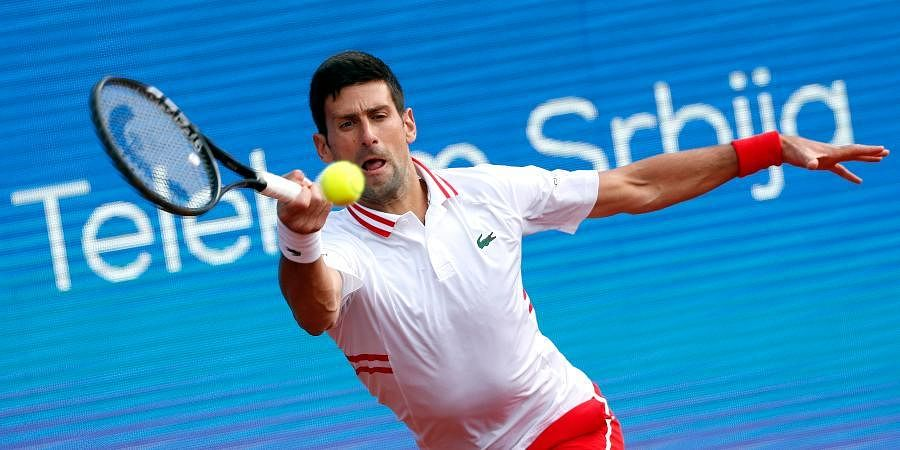 Novak Djokovic returns a ball to Kwon Soon-woo during their tennis match of the Serbia Open in Belgrade.