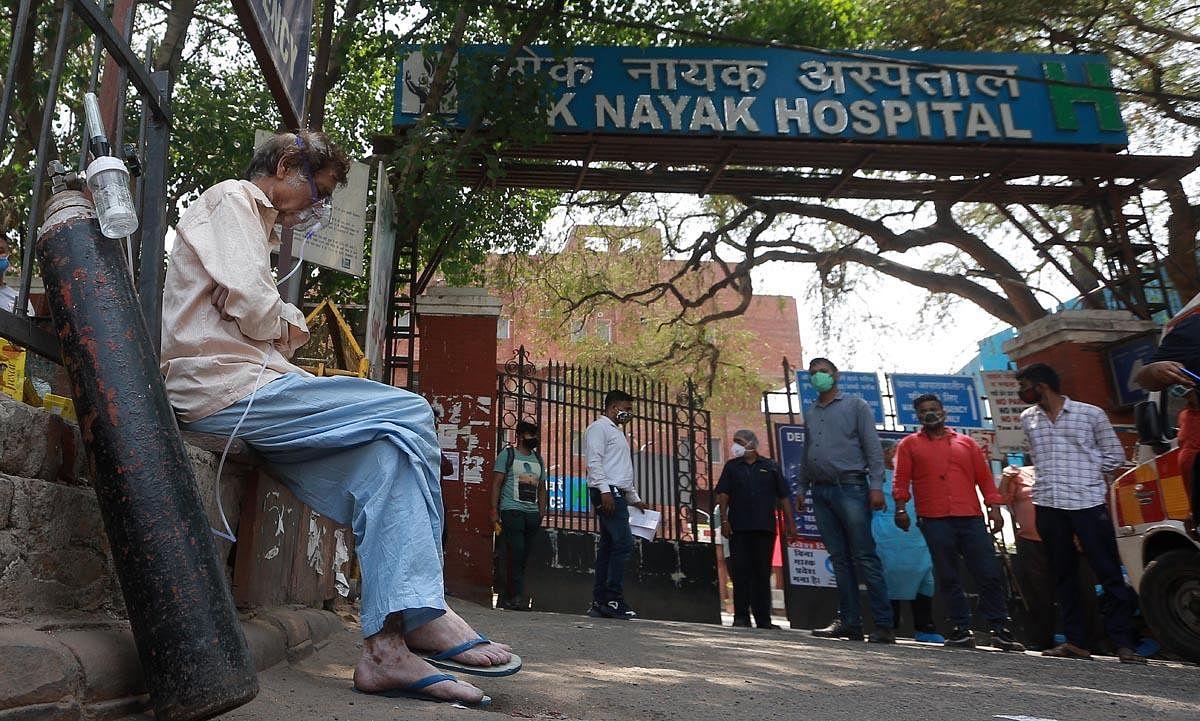 A Covid-19 patient waits for admission outside the Lok Nayak Jaiprakash Narayan Hospital in New Delhi on Thursday. (Photo   Shekhar Yadav, EPS)