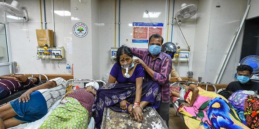 COVID-19 patients left to share beds and medical oxygen at LLR Hospital in Kanpur, amid a shortage in supplies due to surging coronavirus cases across the country. (Photo | PTI)