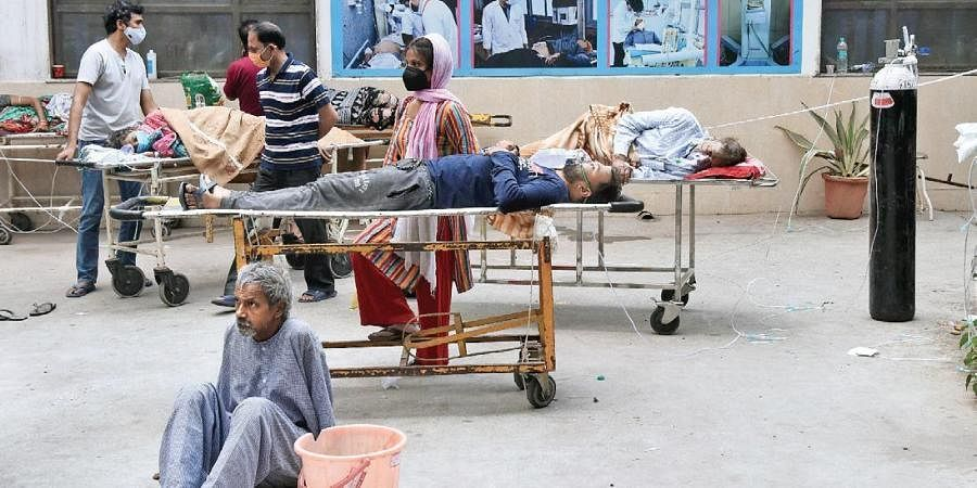 COVID-19 patients await admission at the GTB hospital in Delhi on Friday.