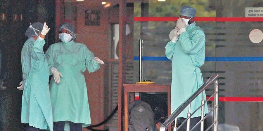 Staff of Sir Ganga Ram Hospital after panic strikes over shortage of oxygen.
