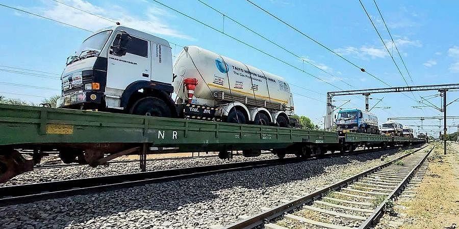 Oxygen tankers loaded on a train wagon