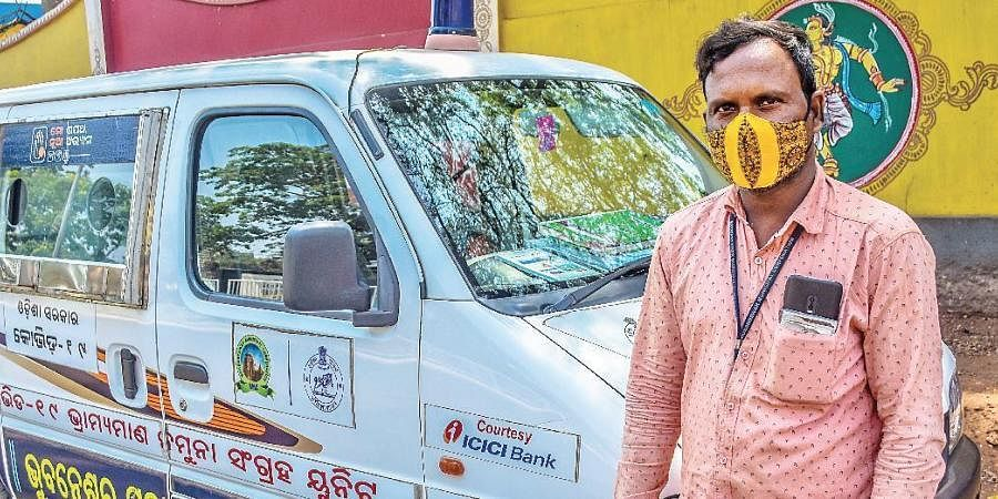 Kishor Chandra Nayak with the BMC van.
