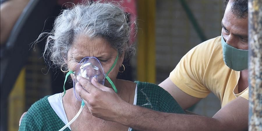 A COVID-19 patient receiving oxygen support in Ghaziabad