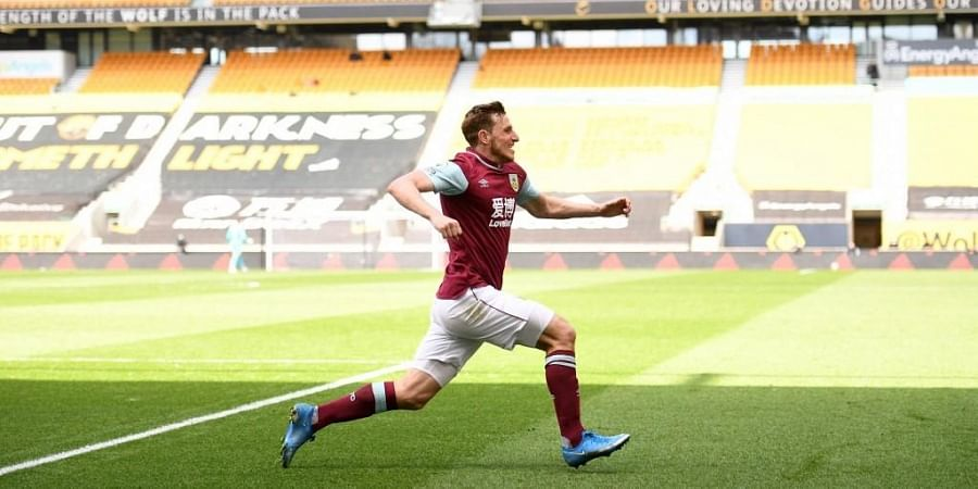 Burnleystriker Chris Wood celebrates scoring his team's third goal during match against Wolverhampton Wanderers at the Molineux stadium, central England on April 25, 2021.