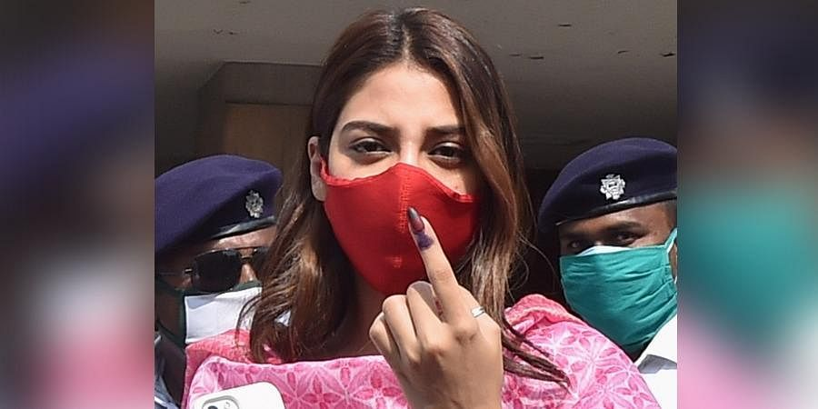 TMC MP Nusrat Jahan shows her finger marked with indelible ink after casting her vote during the 7th phase of the West Bengal State Assembly polls