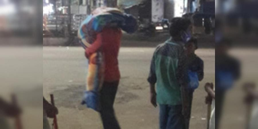 A beggar carried his wife's body on his shoulders to conduct funerals in a burial ground in Telangana's Kamareddy