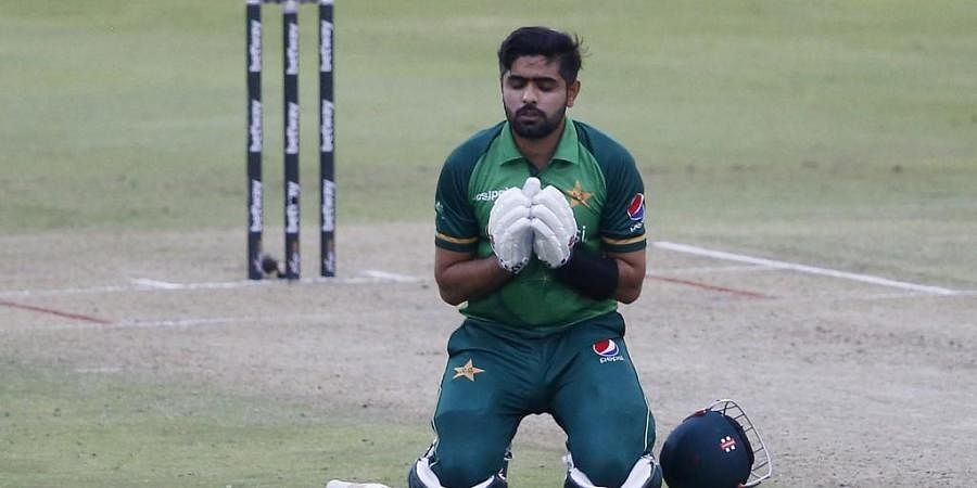 Pakistan's captain Babar Azam kneels down while celebrating after scoring a century (100 runs) during the first ODI cricket match between South Africa and Pakistan. (Photo   AFP)