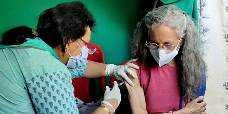 Foreign nationals residing at Kullu receive a dose of COVID-19 vaccine
