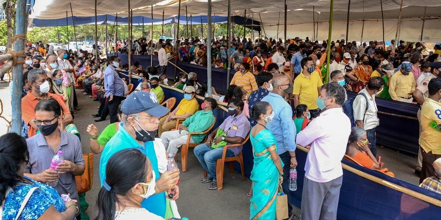 Citizens above the age of 45 wait to receive COVID-19 vaccine at MMRC Dedicated COVID Health Centre at NESCO in Mumbai on Thursday
