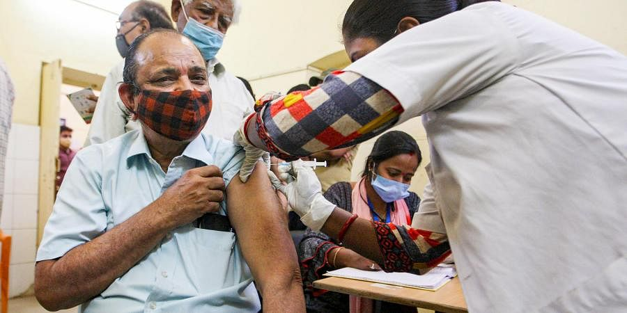 A health worker inoculates COVID-19 vaccine shots to beneficiaries at a vaccination centre in Prayagraj, Monday.