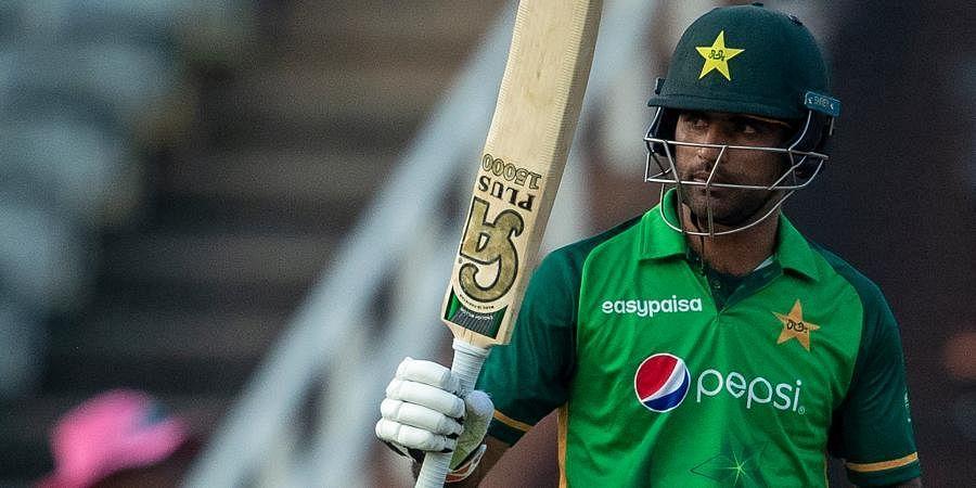 Pakistan batsman Fakhar Zaman raises his bat to celebrate scoring a century during the second ODI matchagainst South Africa at the Wanderers stadium in Johannesburg.