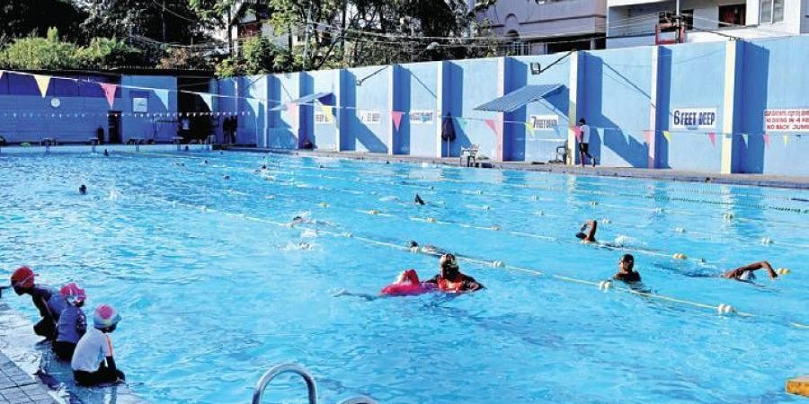 A file picture of kids swimming before pools were ordered shut