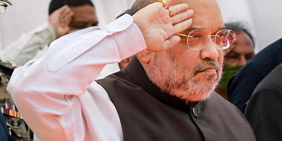 Union Home Minister Amit Shah pays tribute to the 22 CRPF Personnel who lost their lives in Bijapur Naxal attack, in Jagdalpur, Monday. (Photo | PTI)