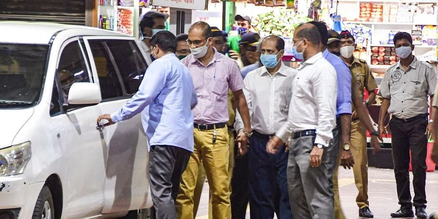 A team of Central Forensic Science Laboratory, Pune with NIA experts recreate the crime scene by taking suspended API Sachin Vaze to a spot at Chhatrapati Shivaji Maharaj Terminus in Mumbai. (Photo | PTI)