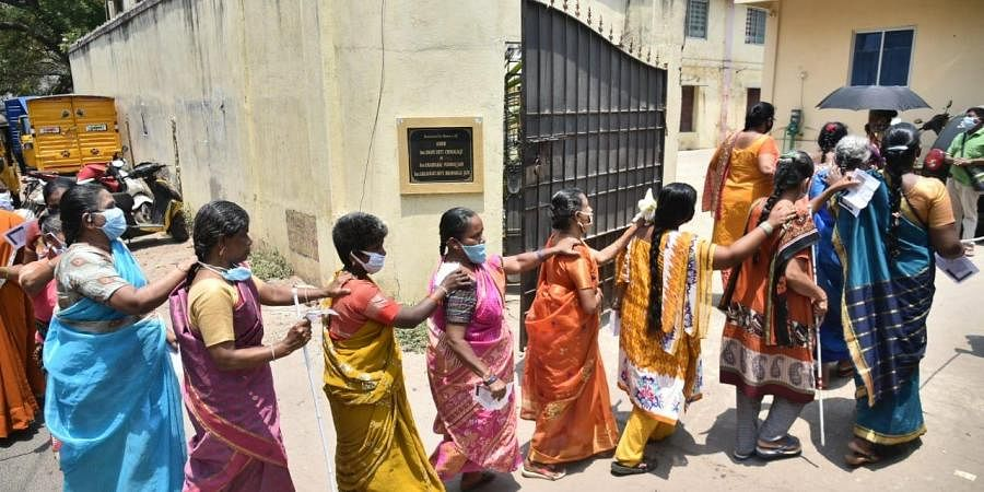 Members of Tamil Nadu association of the blind, Thandiar, on their way to polling booth to cast their vote, in Chennai on Tuesday