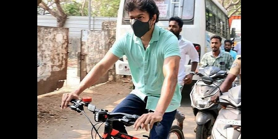 Actor Vijay going to the polling booth via cycle, in Chennai on Tuesday. (Photo | EPS)