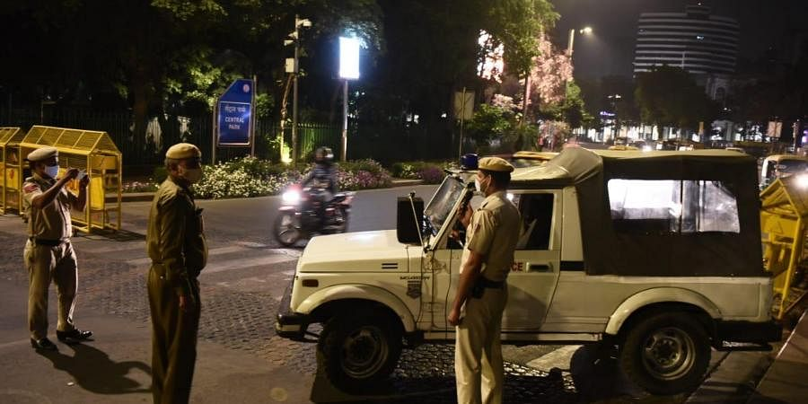 Connaught place wears a deserted look during night curfew, imposed to curb the spread of coronavirus in New Delhi on Tuesday.