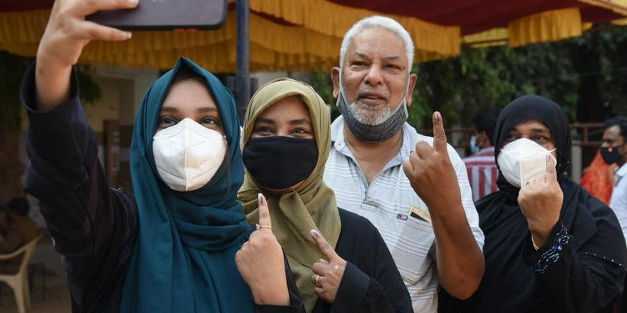 People taking a selfie after casting their vote in Chennai. (Photo | R Satish Babu, EPS)