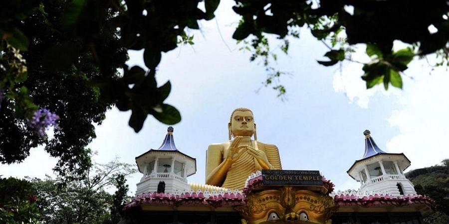 A general view of the natural cave is seen at the Rock Temple (Rangiri Dambulla Rajamaha Viharaya) in Dambulla, some 150 kms north of the Sri Lankan capital Colombo. (Photo   AFP)