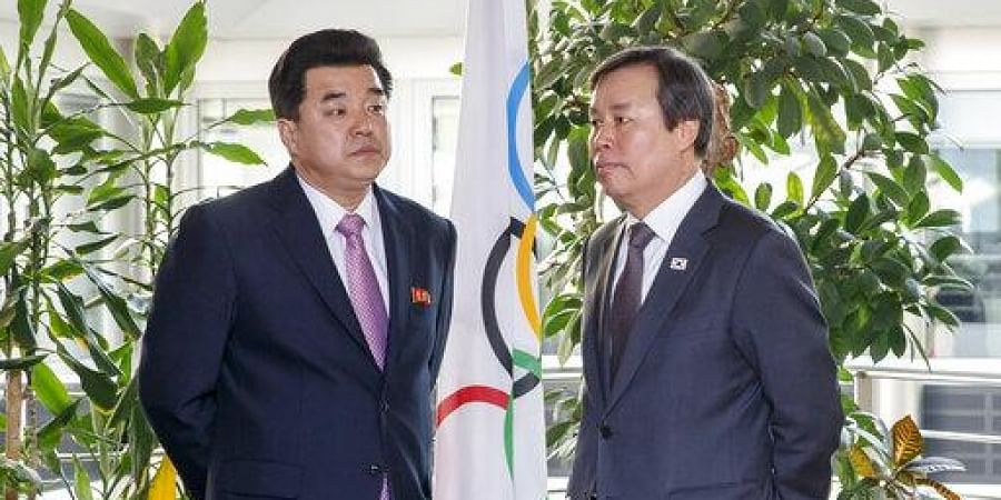 North Korea's Olympic Committee President and Sports Minister Kim Il Guk, left, and South Korean Sports Minister Do Jong-hwan attend a meeting with the IOC. (Photo | AP)