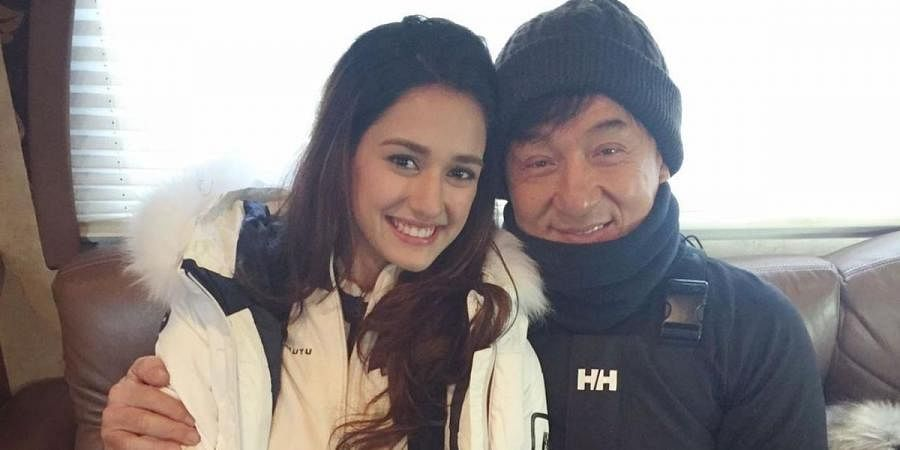 Disha Patani (L) with martial arts legend Jackie Chan