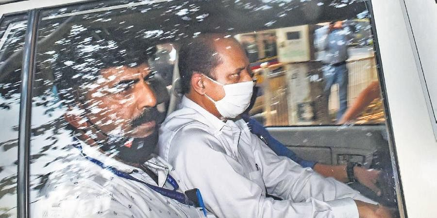 File photo of police officer Sachin Waze being taken to court in Mumbai. (Photo | PTI)